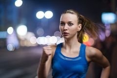 Jogging at night Stock Images