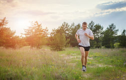Jogging outdoors in the woods Stock Photos