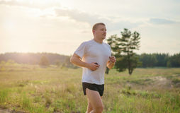 Jogging outdoors in the woods Royalty Free Stock Photography