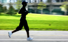 Jogging panning blur silhouett Royalty Free Stock Images