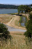 Jogging path by river ocean and field Royalty Free Stock Photo