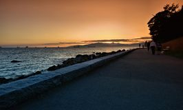Jogging path and seawall along the ocean Stock Image