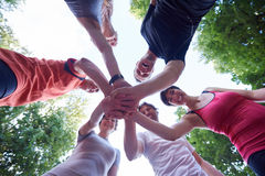 Jogging people group have fun. Jogging people group, friends have fun, hug and stack hands together after training royalty free stock photography