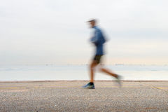 Jogging on a quayside Royalty Free Stock Photography