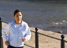Jogging on the riverside Stock Photo
