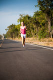Jogging on the road Royalty Free Stock Photos