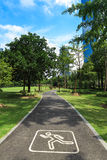 Jogging road in city park Stock Image