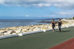 Jogging by the sea stock images