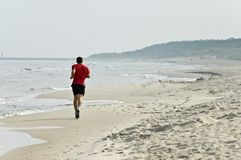Jogging at seashore Royalty Free Stock Images