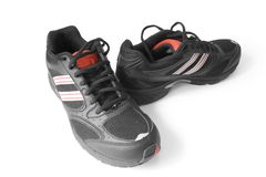 Jogging shoes. Black jogging shoes isolated on white (contains clipping path Stock Image