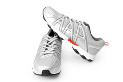 Jogging shoes. Man jogging shoes on white (contains clipping path Stock Photos