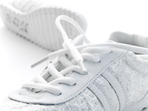 Jogging shoes. Pair of running shoes over the white background Royalty Free Stock Images