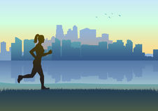 Jogging. Silhouette illustration of a female figure jogging with cityscape as the background Royalty Free Stock Image