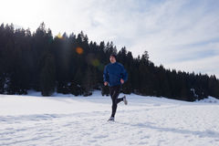 Jogging on snow in forest Royalty Free Stock Images