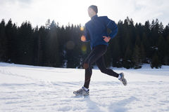 Jogging on snow in forest Stock Photos