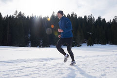 Jogging on snow in forest Royalty Free Stock Photos
