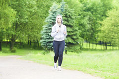 Jogging Sport Concept: Running Fitness Woman Training Outdoors a Stock Photo