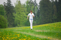 Jogging - sportive woman running in park Stock Images
