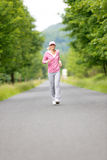 Jogging sportive young woman running park road Stock Photo