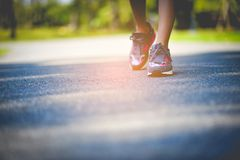 Jogging with sports shoes on holiday For health and beauty. And fat reduction. stock photography