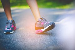 Jogging with sports shoes on holiday For health and beauty. And fat reduction. royalty free stock images