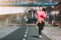 Jogging. Sporty beautiful girl in sportswear jogging. Beautiful young athlete woman working out. Fitness concept stock photo