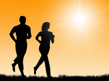 Jogging in the sun. Couple jogging together in the bright sun Royalty Free Stock Photo