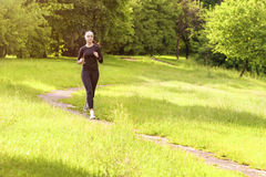 Jogging Theme: Caucasian Sportswoman Having Jogging Exercises Ou Royalty Free Stock Photos