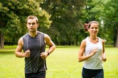 Jogging together - young couple running Royalty Free Stock Image