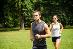 Jogging together - young couple running Royalty Free Stock Photography