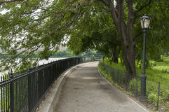Jogging track around lake in Central Park, New York. Photo shot from inside Central Park in New York Royalty Free Stock Photos