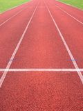 Jogging track, outdoor oval stadium with a tartan track. Stock Photo