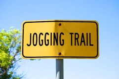 Jogging Trail Sign. A yellow and black jogging trail sign at White Rock Lake Stock Photography