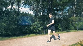 Jogging training of a young man with a robotic bionic arm. Jogging training of a young man with a synthetic arm. 4K