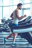 Jogging on treadmill. Royalty Free Stock Images