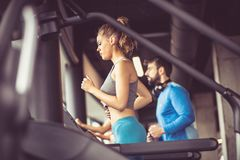 Jogging on treadmill. royalty free stock photography
