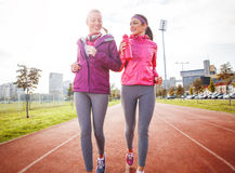 Jogging. Two attractive female jogging together on beautiful morning stock image