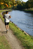 Jogging by the water Stock Photography