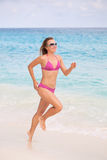 Jogging on White Sandy Beach Royalty Free Stock Photos