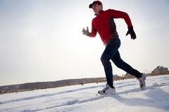 Jogging in winter Stock Images