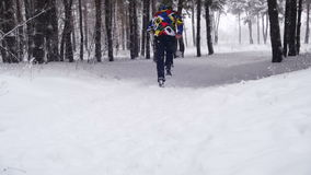 Jogging in the Winter Forest. Slow Motion stock video
