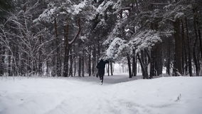 Jogging in the Winter Forest. Slow Motion stock footage