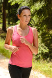 Jogging woman close-up running in countryside Royalty Free Stock Photography