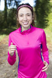 Jogging woman in forest in autumn Stock Photo