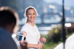 Jogging woman portrait. Portrait of jogging woman before running on early morning with sunrise in background royalty free stock photography