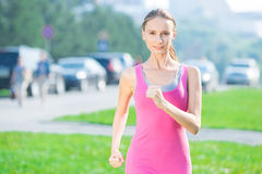 Jogging woman running in city park Royalty Free Stock Photos