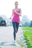 Jogging woman running in city park Royalty Free Stock Images