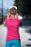 Jogging woman setting phone before jogging Stock Images