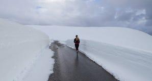 Jogging woman. Woman jogging on snow Stock Photos