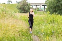 Jogging woman at summer midday. Stock Photo